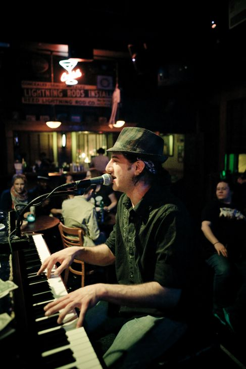 Tommy Sklut plays dueling pianos at Sluggers in Wrigleyville
