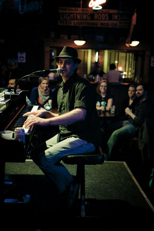 Tommy Sklut plays Chicago Dueling Pianos at Sluggers in April